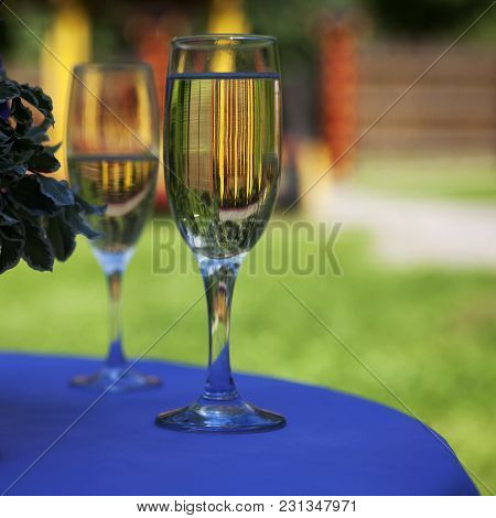 Bridal Bouquet And Two Glasses Of Champagne.