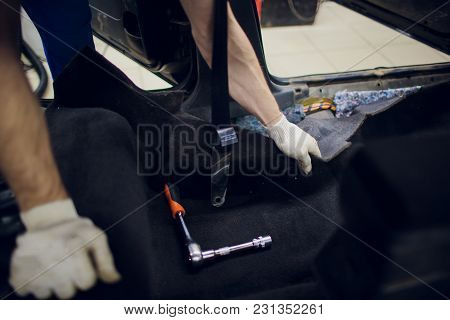 Dismantling Of The Floor In The Car Mechanic Male Man Removes The Floors In The Car