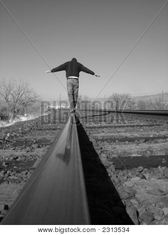 Man On Railroad Tracks