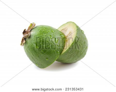 Two Pieces Feijoa On A White Background. Exotic Fruit Flat Lay