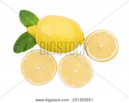 Fresh Sliced Lemon With The Leaves On A White Background. Lemon Flat Lay