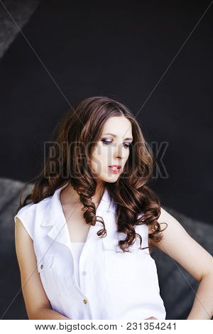 Beautiful Fashion Model Girl With Brunette Hair. Portrait Of Glamour Woman  Isolated On Black Backgr