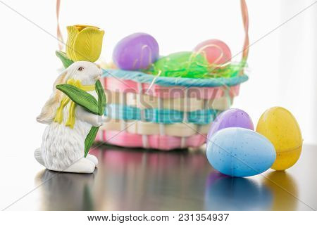 An Easter Bunny Is Set A Long Side His Basket Filled With Easter Eggs. Plastic Eggs Are Also Grouple