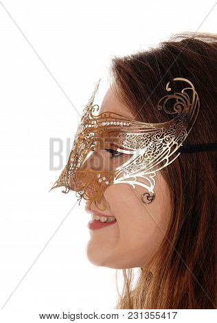 A Head Shot Of A Young Gorgeous Woman With Long Brunette Hair Wearing A Gold Mask On Her Face, Isola