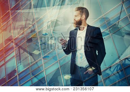 Businessman In Office Looks Far For The Future. Concept Of Innovation And Startup