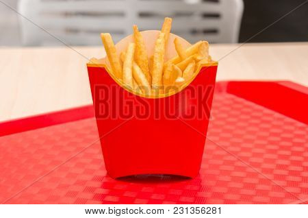 French fries in red box on a tray