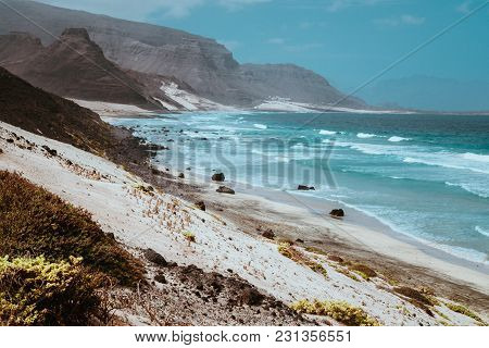 Stunning View Over Barren Rugged Volcanic Cliffs And Sand Dunes. Vast Plain Of The Coastline. Baia D