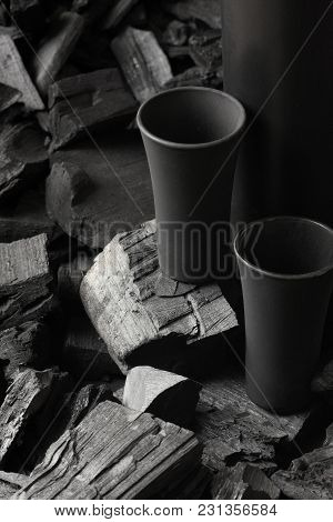 Two Matte Black Shot Glass .on Charcoal Background. Black Edition.creative.let's Drink.cheers.mockup