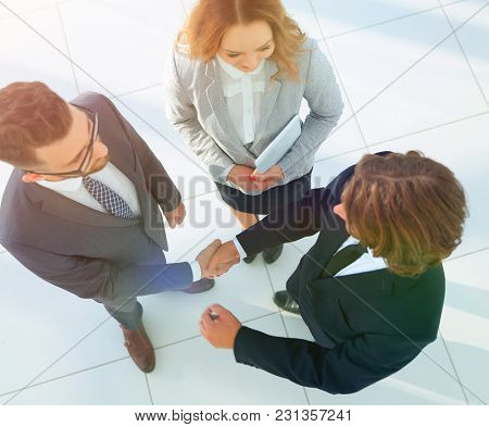 Business men shaking hands making an agreement