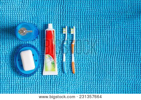 Colored Toothbrushes, Tube Of Toothpaste, Blue Dispenser For Liquid Detergent And Soap Dish With Whi