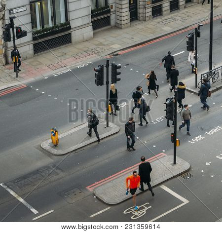 London, United Kingdom- March 13, 2018: High Perspective View Of Officer Worker Pedestrians In The C