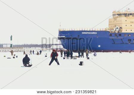Fishermans On Ice. Mans Fishing On Ice On Gulf On Finland Near Kronshtadt, Saint Petersburg, Russia,