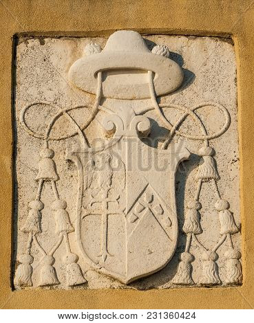 Old Ecclesiastical Emblem Of Cardinal Or Bishop With Tassels On A Wall In Venice
