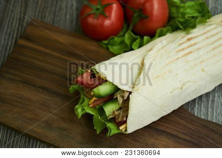 Shaurma Sandwich Chicken Roll In A Pita With Fresh Vegetables Tomatoes , Cucumber, Latitude, Cheese