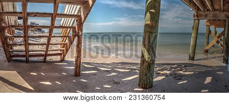 Boardwalk Across The White Sand Beach And Aqua Blue Water Of Clam Pass