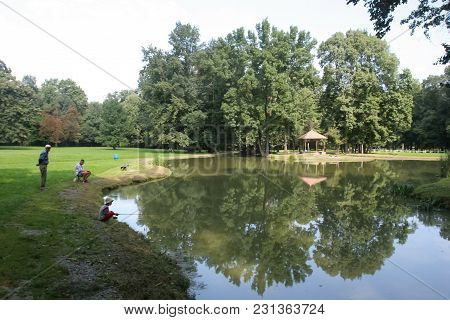 Nasice, Croatia - 3rd September, 2005 : People Fishing On The Lake In The Park Behind The Pejaevi Ca