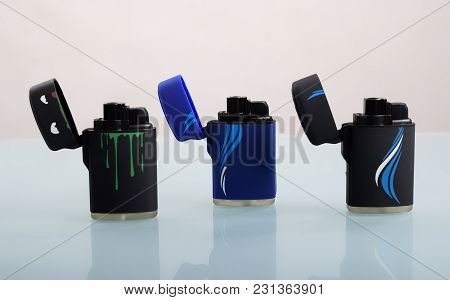 Three Opened Cigarette Lighters On White Background