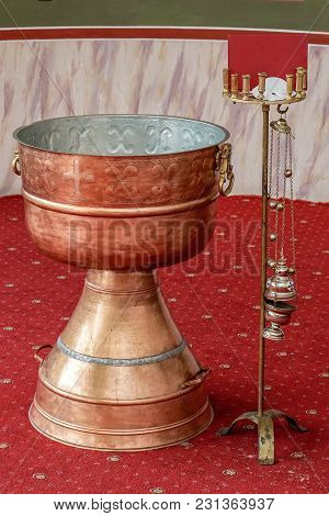 Orthodox Baptism Bowl Of Holy Water And Candles In Baptistery