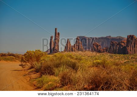Rock Formations Called Totem Pole And Yei Bi Chei In Iconic Monument Valley, Arizona
