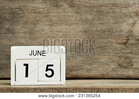 White Block Calendar Present Date 15 And Month June On Wood Background