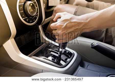 Male Hand Using A Car Automatic Gear / Driving Automobile With Automatic Gears Concept