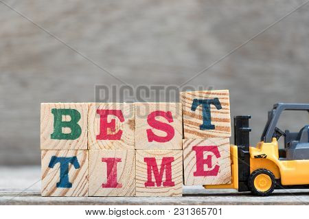 Toy Forklift Hold Letter Block T And E To Complete Word Best Time On Wood Background