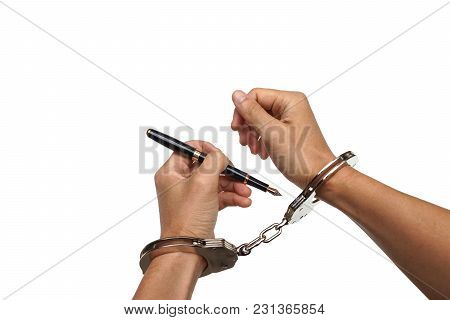 Hand Using A Pen Trying To Unlock Handcuffs - Freedom Of The Press Is At Risk Concept - World Press