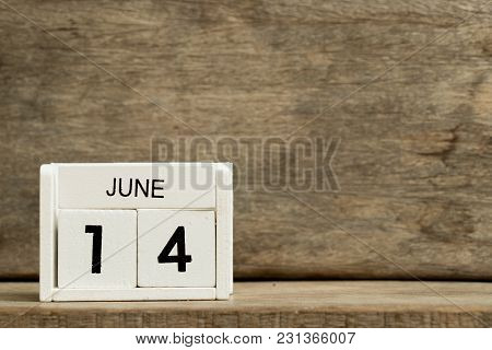 White Block Calendar Present Date 14 And Month June On Wood Background