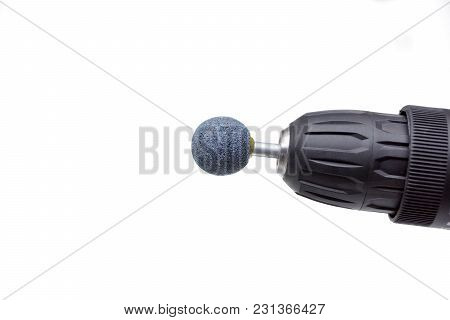 Closeup Of A Screwdriver With Sander Drill Bits Isolated