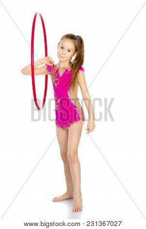 A Girl Gymnast Performs An Exercise With A Hoop. The Concept Of Gymnastics And Fitness. Isolated On