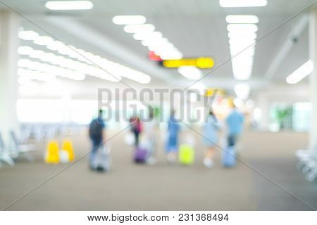 Blurred People At Airport Terminal With Bokeh Light Background, Transportation Concept