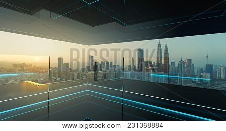 Rear view of a businessman looking at large city center. Concept of success and appreciation. Mixed