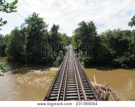 A  Train  Trestle  Crossing  A  Muddy  River  In  Middletown,  Pennsylvania