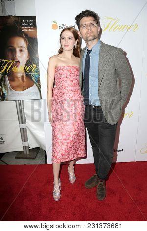 LOS ANGELES - MAR 13:  Zoey Deutch, Adam Scott at the