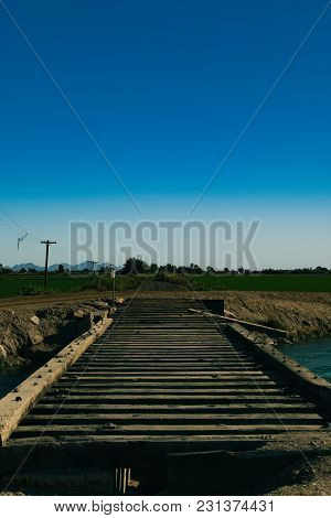 A Nice And Bright Sunny Day, In A Small Desert Town Walking Along Side An Old Abandoned Railroad Tra