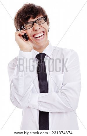 Young hispanic man wearing black glasses, white shirt and black thin tie, laughing out loud during phone talk isolated on white background - prank call, fun and humor concept