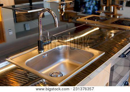 Mettalic Sink In A Modern Kitchen