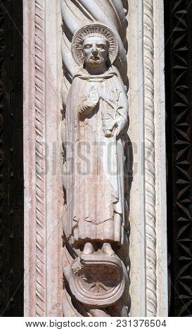 VERONA, ITALY - MAY 27: Saint Peter of Verona, statue on Facade of Saint Anastasia Church in Verona, Italy, on May 27, 2017.