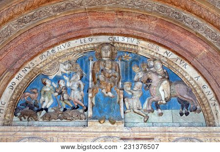 VERONA, ITALY - MAY 27, 2017: Virgin holding the Christ child, centered between, the Annunciation to the Shepherds and the Adoration of the Magi, Cathedral dedicated to the Virgin Mary in Verona.