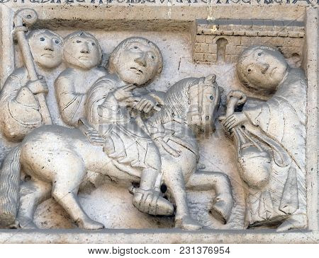 MODENA, ITALY - JUNE 04: Scenes from the life of St. Geminiano: return from the journey of San Geminianus  to the east, bass relief by Wiligelmo, Modena Cathedral, Italy on June 04, 2017.