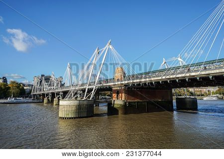London / Uk - November 18 2017: Queen's Golden Jubilee Footbridges Across The Thames River In Blue S