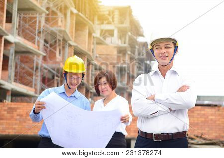 Asian Project Team At The Building Construction Site
