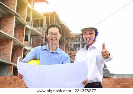 Asian Engineers Posing At The Construction Site
