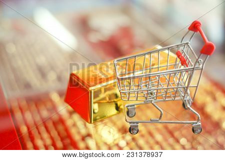 Gold Bar And Shopping Cart Blurry Bg