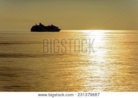 Ocean Sunset And Vessel On Horizon - View From Board Of Vessel