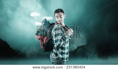 Young Man Carry A Mountain In His Backpack.