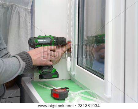 Man With Electric Drill Working At Home, Closeup Indoor Shot