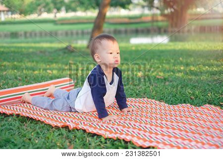 Cute Little Asian 18 Months / 1 Year Old Toddler Baby Boy Child Concentration On Practices Yoga In C