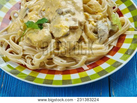 Creamy Tuscan Garlic Chicken - Juicy Crusted Chicken Served Over Noodles With A Delicious Creamy Tus
