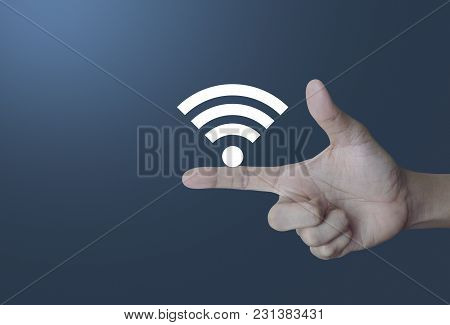 Wifi Icon On Finger Over Light Gradient Blue Background, Technology And Internet Concept